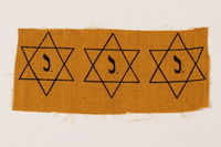 2007.14.4 front Sheet of three uncut, factory-printed Star of David badges printed with a J acquired by a Belgian Catholic rescuer  Click to enlarge