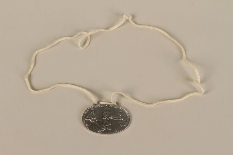 2008.319.1 front Identification tag with name and birthdate issued to a Jewish refugee child