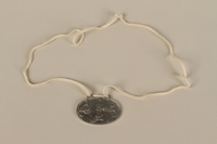 2008.319.1 front Identification tag with name and birthdate issued to a Jewish refugee child  Click to enlarge