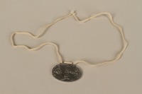 2008.319.2 front Identification tag with name and birthdate issued to a Jewish refugee child  Click to enlarge