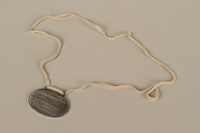 2008.319.2 back Identification tag with name and birthdate issued to a Jewish refugee child  Click to enlarge