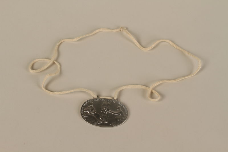 2008.319.3 front Identification tag with name and birthdate issued to a Jewish refugee child