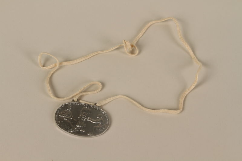 2003.319.4 front Identification tag with name and birthdate issued to a Jewish refugee child