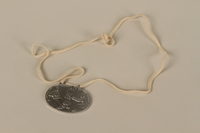 2003.319.4 front Identification tag with name and birthdate issued to a Jewish refugee child  Click to enlarge