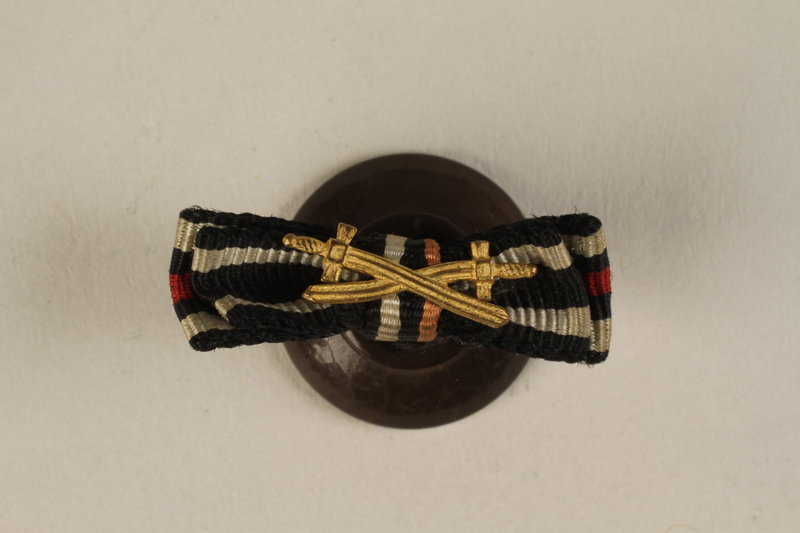 1988.156.1.1 front World War I Honor & Iron Crosses buttonhole ribbon bar with Combatant's swords awarded to a German Jewish soldier