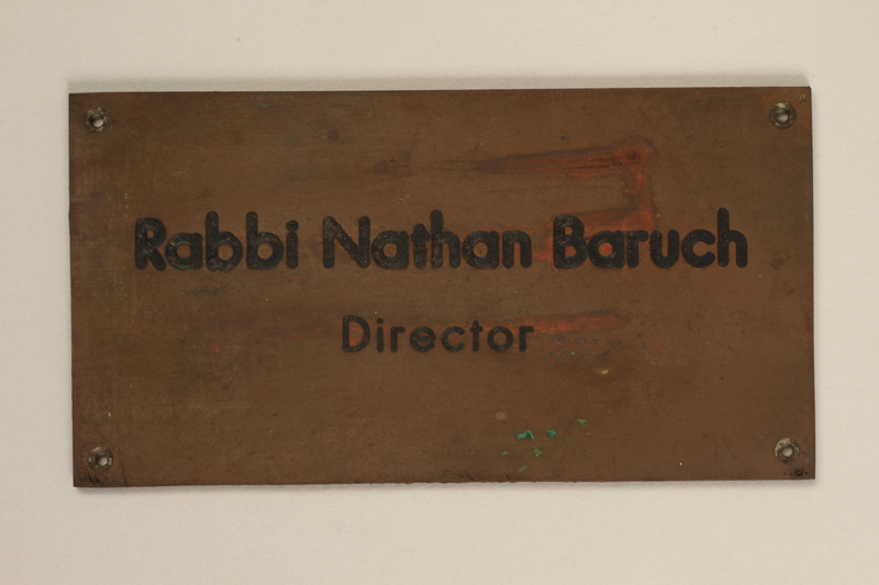 2008.180.7 front Engraved brass wall nameplate for the director of the Vaad Hatzala Emergency Committee in postwar Germany
