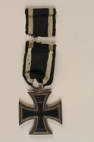 1988.156.1.2_a-b back World War I Iron Cross 2nd class combatant's medal with ribbon awarded to a German Jewish soldier  Click to enlarge
