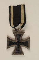 1988.156.1.2_a front World War I Iron Cross 2nd class combatant's medal with ribbon awarded to a German Jewish soldier  Click to enlarge