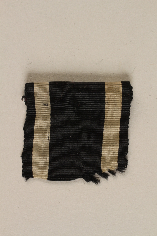 1988.156.1.2_b front World War I Iron Cross 2nd class combatant's medal with ribbon awarded to a German Jewish soldier