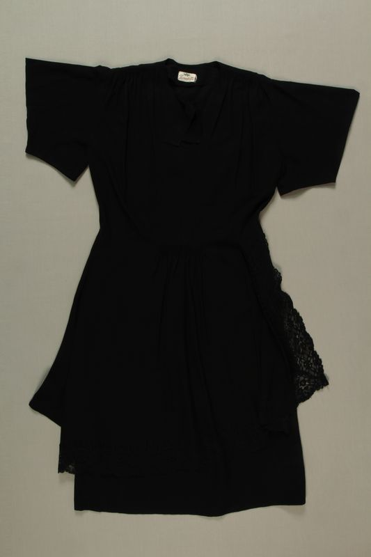 2009.117.3 front Black layered evening dress brought with a Polish Jewish emigre