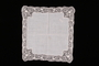 Embroidered white handkerchief with floral lace border brought with a Polish Jewish emigre