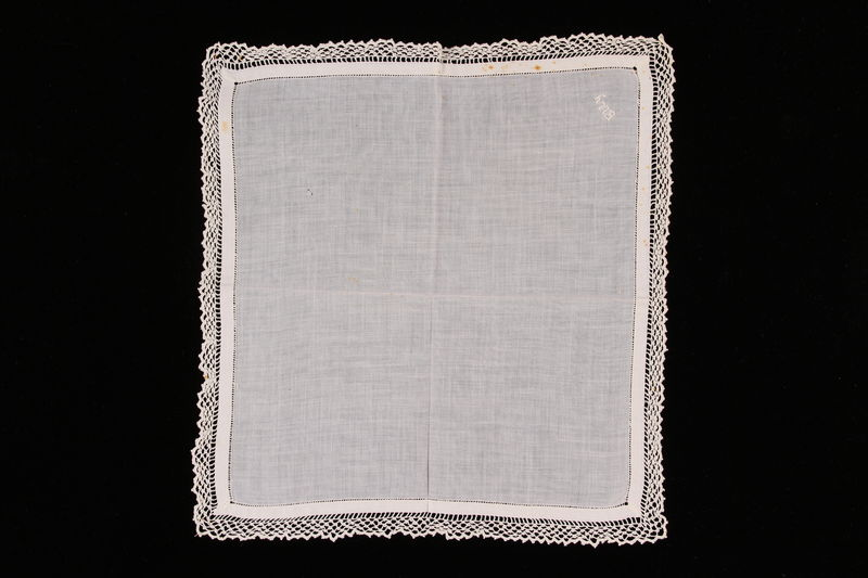 2009.117.7 front Embroidered white handkerchief with crochet border brought with a Polish Jewish emigre