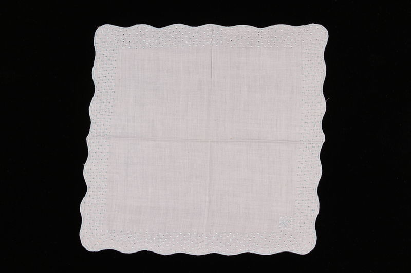 2009.117.8 front Embroidered white handkerchief with scalloped edge brought with a Polish Jewish emigre