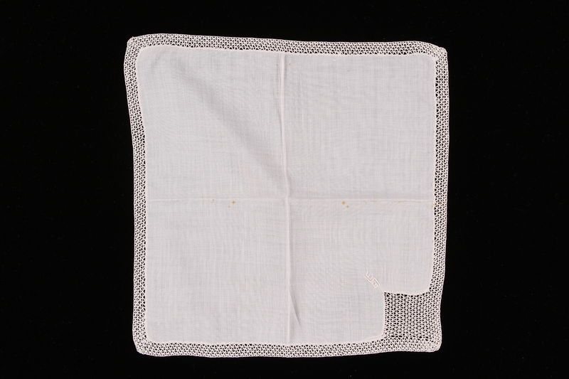 2009.117.9 front Embroidered white handkerchief with crocheted border brought with a Polish Jewish emigre