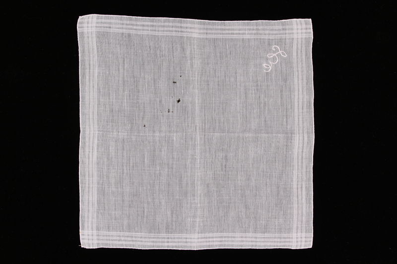 2009.117.10 front Embroidered white handkerchief with woven lines brought with a Polish Jewish emigre