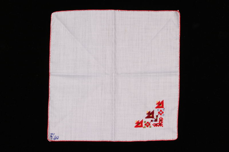 2009.117.12 front Handkerchief with multi-colored embroidery brought with a Polish Jewish emigre
