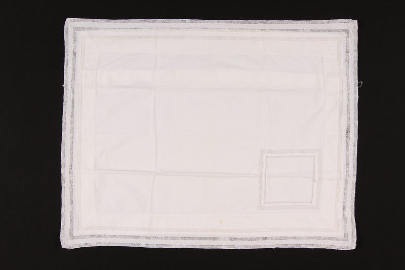 2009.117.18 front Embroidered white pillow sham brought with a Polish Jewish emigre
