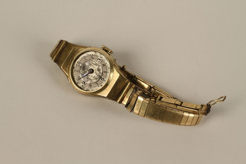 2009.119.2 front Woman's engraved gold wrist watch given to one inmate by another in Auschwitz
