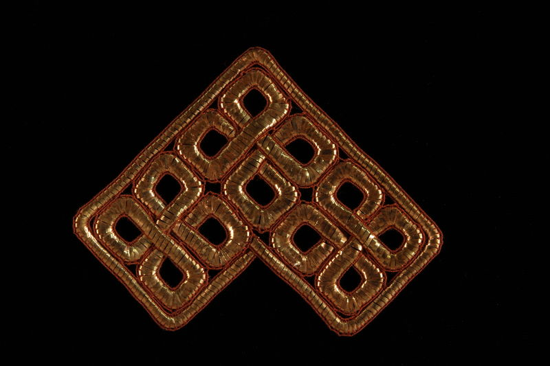 2009.117.21 front Metallic bronze tallit decoration of entwined squares brought with a Polish Jewish emigre