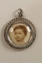 Silver locket with an engraved monogram and an infant's photo saved by an Austrian refugee family