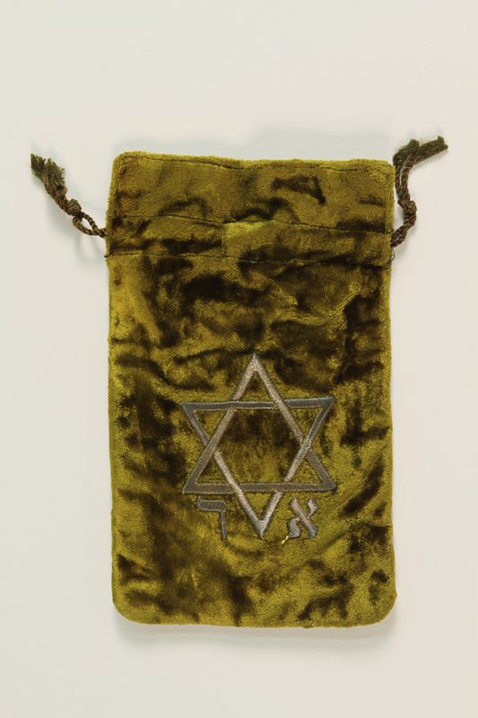 2009.147.2_c front Pair of tefillin with an embroidered green velvet bag used by a Czech Jewish refugee