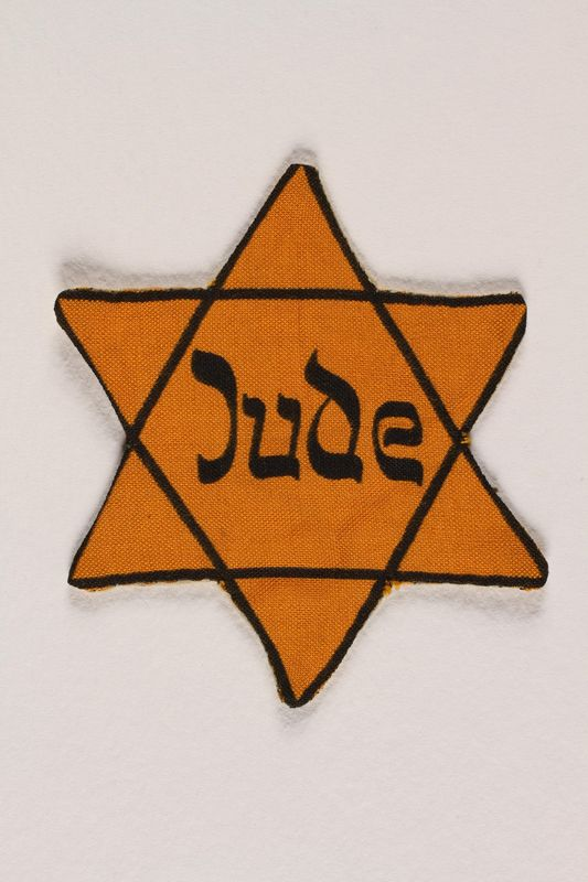 2008.343.2 front Star of David badge printed with Jude worn to identfiy a Jew in Vienna