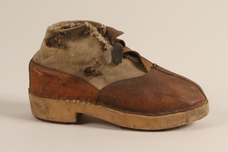 1990.333.60 a front Handmade shoes worn by an inmate of Buchenwald concentration camp
