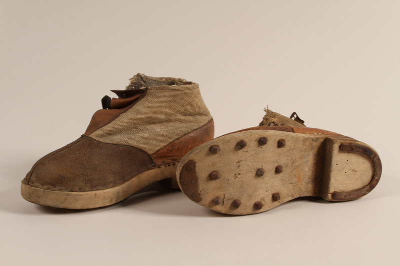 1990.333.60 a-b front Handmade shoes worn by an inmate of Buchenwald concentration camp