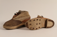 1990.333.60 a-b front Handmade shoes worn by an inmate of Buchenwald concentration camp  Click to enlarge