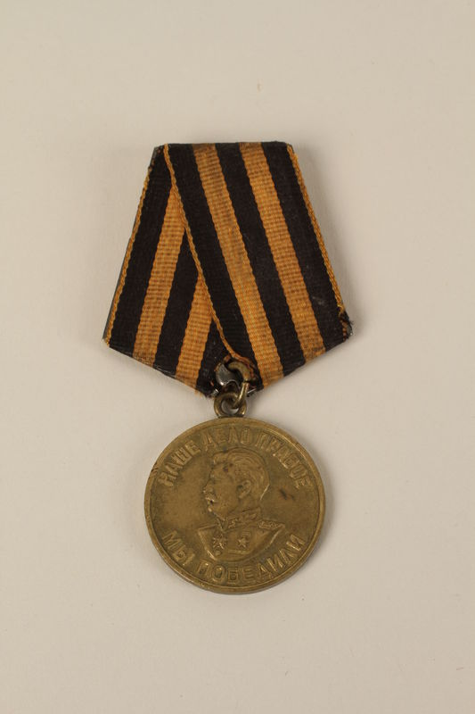 2009.196.5 front Medal for Victory over Germany in the Great Patriotic War 1941-1945 awarded to a Jewish Polish veteran of the Soviet Army