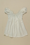 Child's white smocked dress worn by 2 sisters while living in hiding