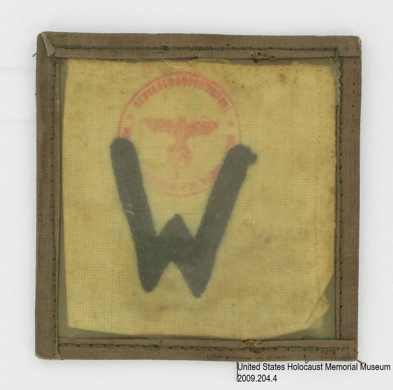 2009.204.4 front Cloth work pass with an embroidered black W used to enter and exit the Lvov ghetto