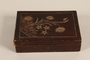 Wooden box with carved floral decorations used by a hidden child