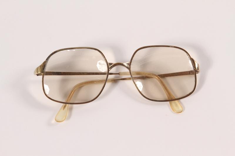 2009.204.8 front Gold metal eyeglasses worn by a former resident of the Lvov ghetto