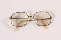 2009.204.8 front Gold metal eyeglasses worn by a former resident of the Lvov ghetto  Click to enlarge