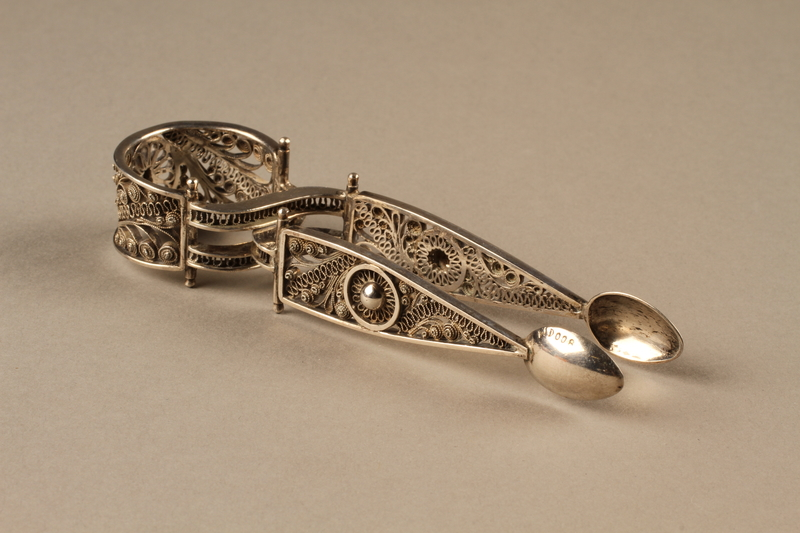 2006.498.2 side a Silver sugar tongs carried by a Kindertransport refugee
