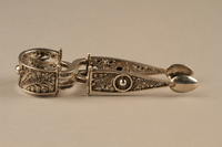 2006.498.2 side c Silver sugar tongs carried by a Kindertransport refugee  Click to enlarge