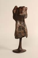 1990.337.1 back. Bronze sculpture of a woman resting in the shelter of a cupped hand  Click to enlarge