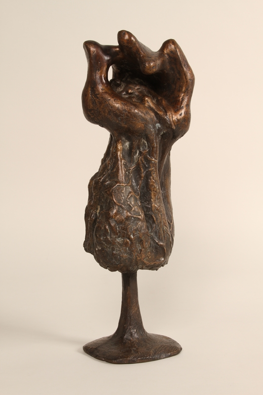 1990.337.1 front Bronze sculpture of a woman resting in the shelter of a cupped hand