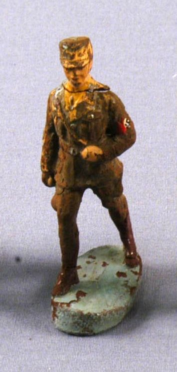 Toy Nazi SA figurine in a brown uniform with swastika armband acquired by a US family in Vienna