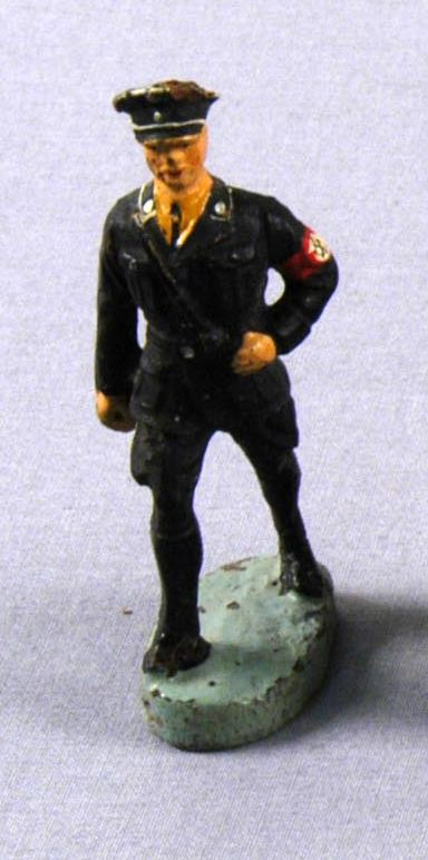 Toy Nazi SS figurine in a black uniform with swastika armband acquired by a US family in Vienna