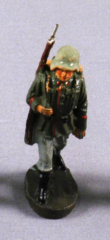 Toy Nazi Wehrmacht figurine in a green uniform with a rifle acquired by a US family in Vienna