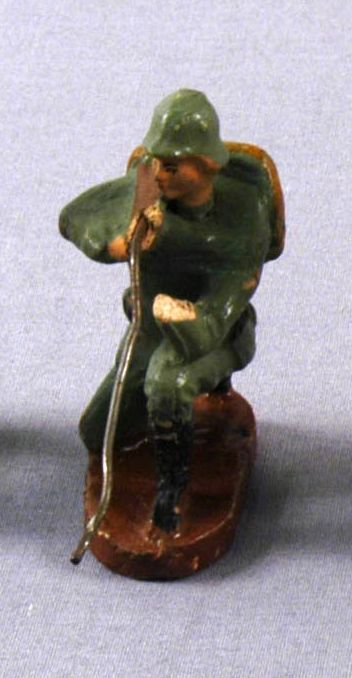 Toy Nazi Wehrmacht figurine in a green uniform crouching with a rifle acquired by a US family in Vienna