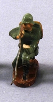 Toy Nazi Wehrmacht figurine in a green uniform crouching with a rifle acquired by a US family in Vienna  Click to enlarge