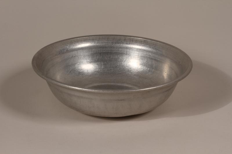 1990.36.16 front Metal basin