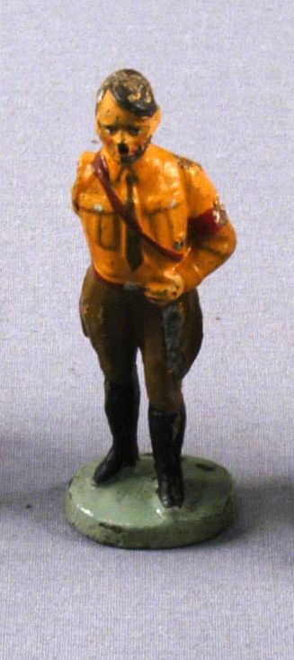 Toy figurine of Hitler in a brown belted uniform acquired by a US family in prewar Vienna