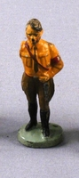 Toy figurine of Hitler in a brown belted uniform acquired by a US family in prewar Vienna  Click to enlarge