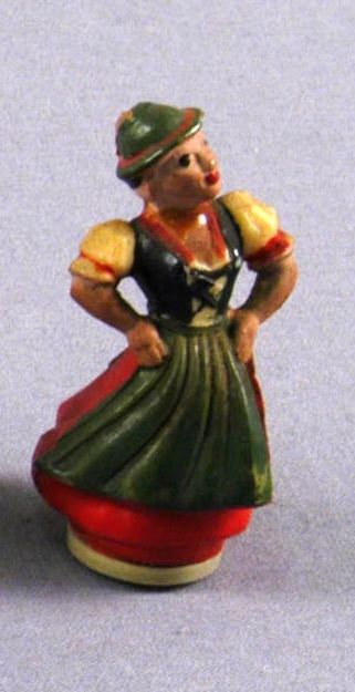 Toy figurine of a woman in traditional Austrian dress acquired by a US family in prewar Vienna