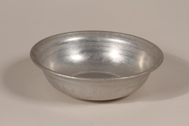 1990.36.24 front Metal basin
