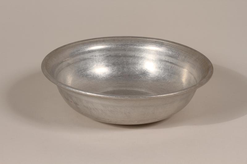 1990.36.25 front Metal basin